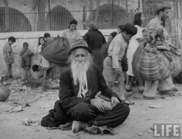 Elderly Jewish man sitting in street after surrender of city. Jerusalem, Israel. June 1948. John Phillips
