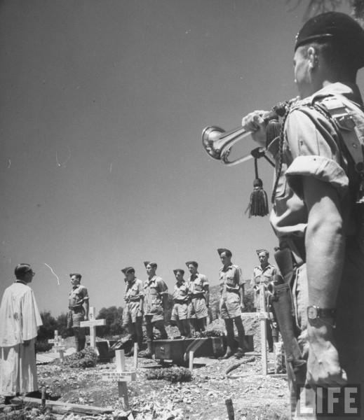 Bugler playing the Last Post at funeral of  a British soldier. June 1948. Frank Scherschel
