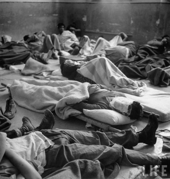 Jewish soldiers lying injured in hospital after surrender of city. Jerusalem, Israel. June 1948. John Phillips