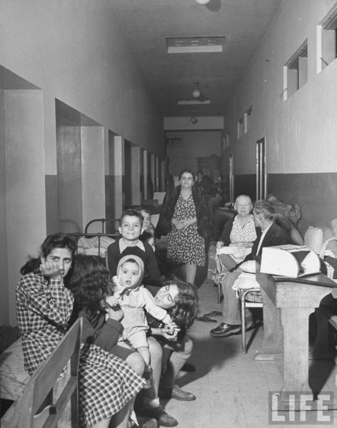 Shelter in corridor of a school building. 1948. Dmitri Kessel