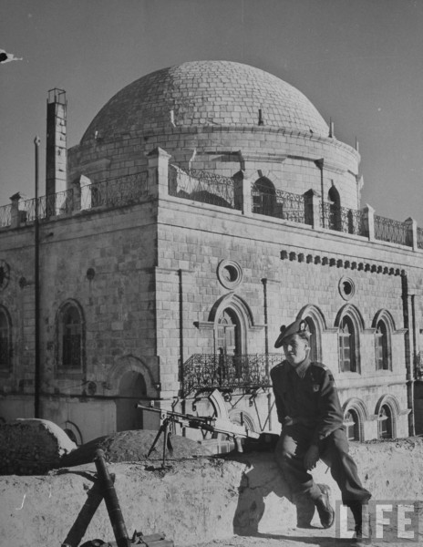 A British soldier sitting guard on a rooftop. (Is this Haruvah?). 1948. Dmitri Kessel