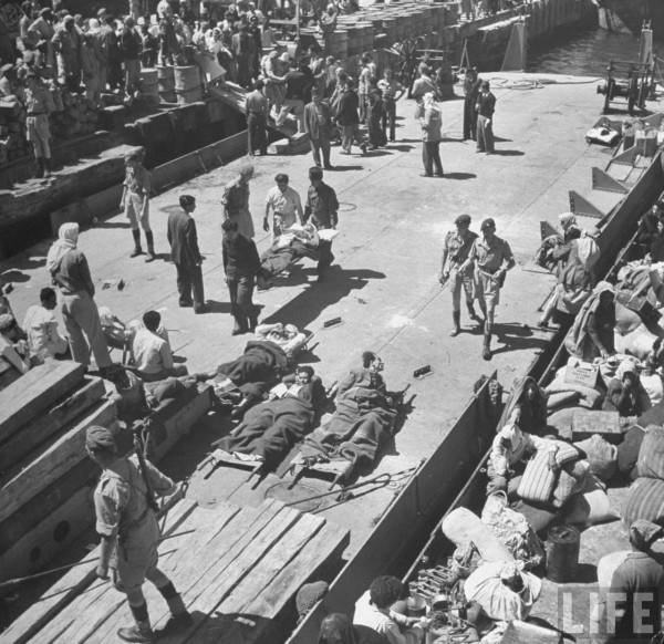 Arab refugees on a dock. Hafia, Israel, May 1948, John Phillips