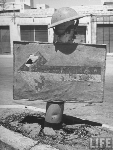 A sign indicating Army traffic in Hafia. May 1948. John Phillips