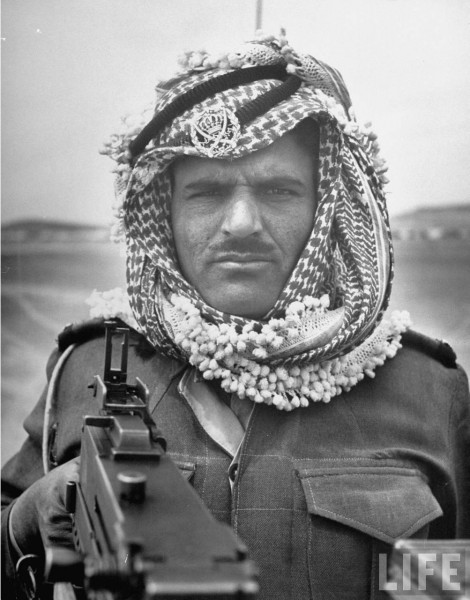 An Arab Legionnarie pointing his gun at  John Phillips, April 1948
