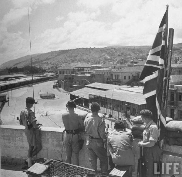 British Marines guarding a deserted street of Haifa