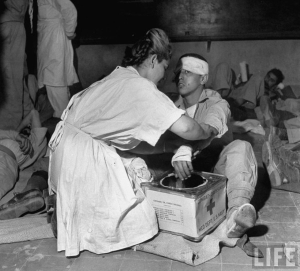 Nurse treating wounded Jewish soldier in Jerusalem