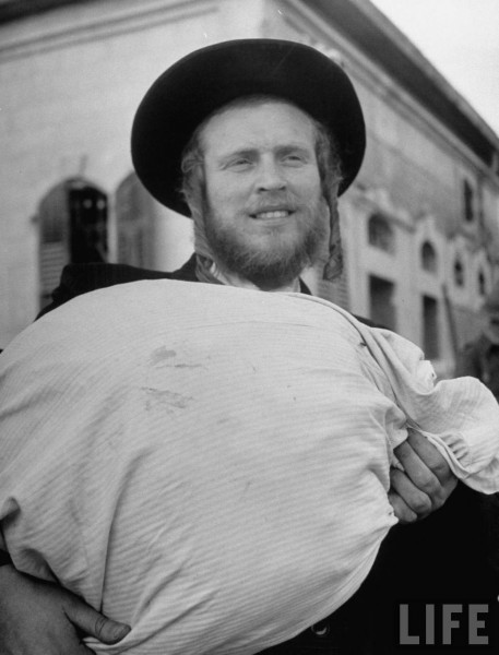 Orthodox Jewish man preparing to evacuate the city