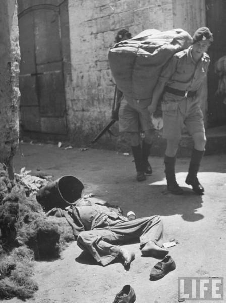 A 13-yr-old Arab boy lying dead on street of Haifa