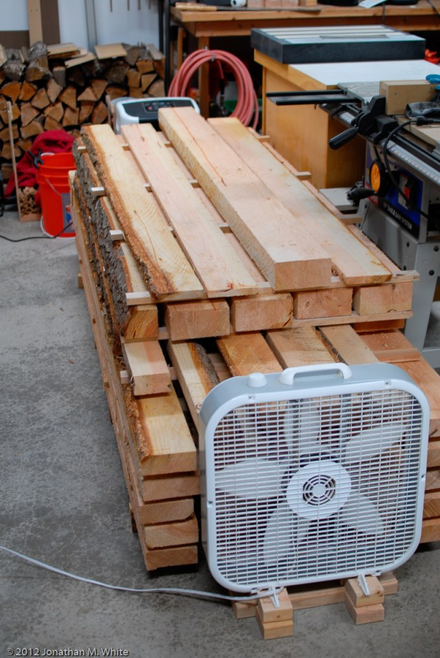 Here is my lumber pile all set up for drying. I have a fan at one end and a dehumidifier at the other.