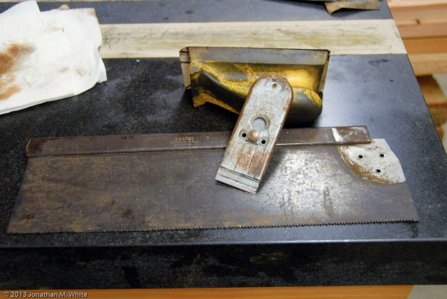 A common razor scrapper is the first tool I use to clean a saw plate.