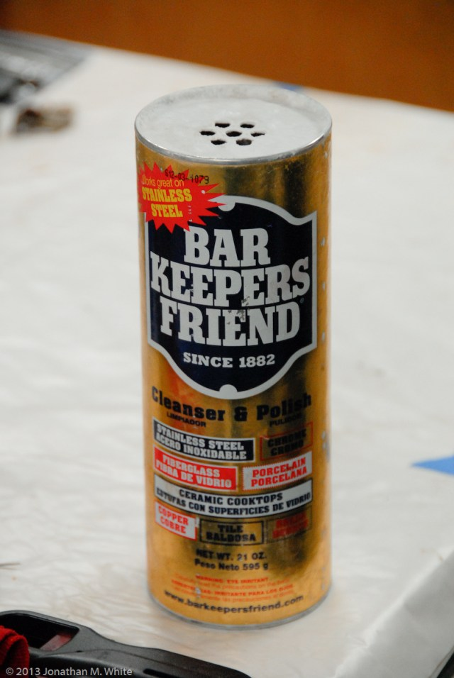 Bar Keepers Friend. This stuff works fantastically with a soft nail brush to clean brass parts.