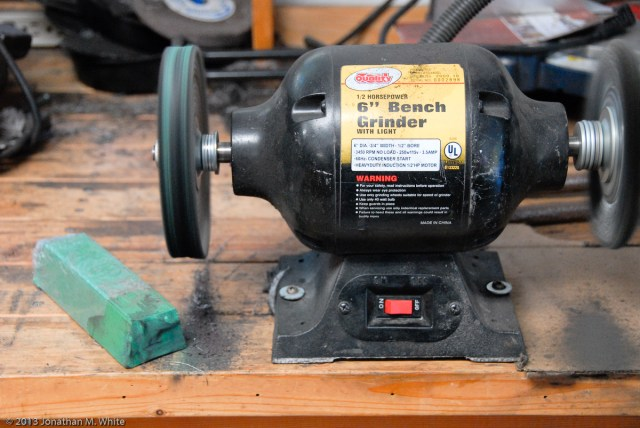 """My bench grinder with a Grizzly 6"""" 60 ply spiral sewn buffing wheel and their green (fine) compound."""