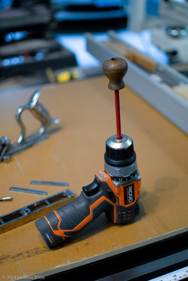 I mounted the knob on a driver bit and put in the drill to sand it.