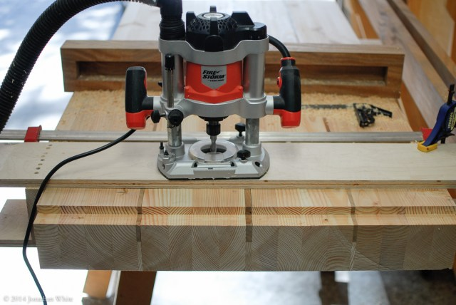 My plunge router and the jig I built to line up the shoulders on the top and bottom.