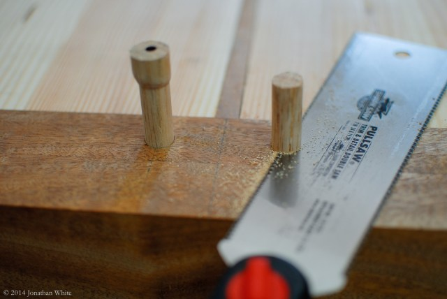 I trimmed the oak draw bore pegs flush with the breadboard ends.