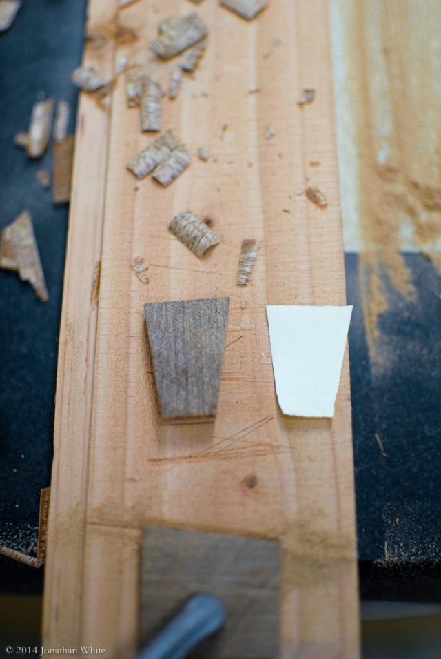 I pared and sanded the dovetail patch until it matched the paper template.