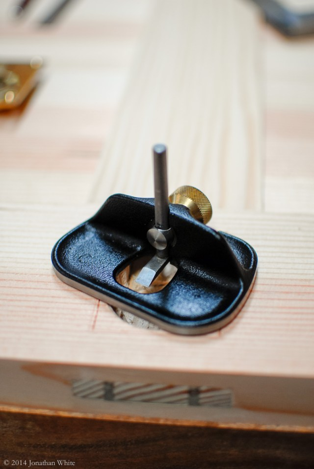 I used a small router plane to mortise in for the flat part of the ring pull.