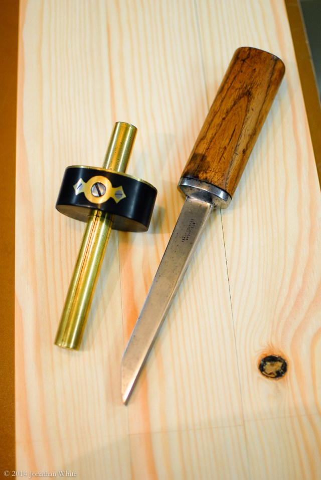 A mortise gauge and mortise chisel.