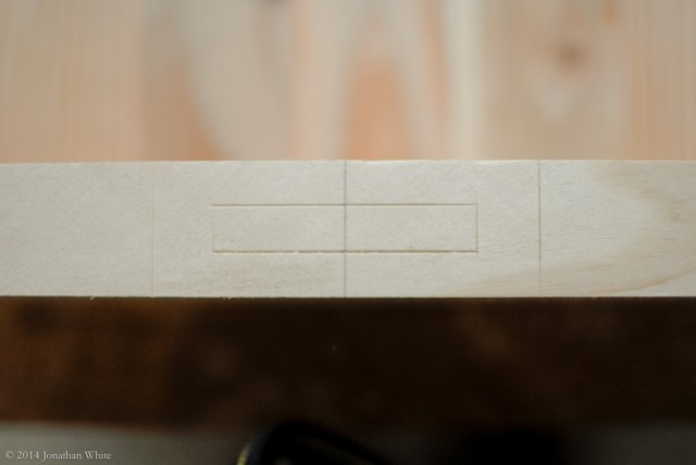 The mortise location laid out with the gauge and a knife.