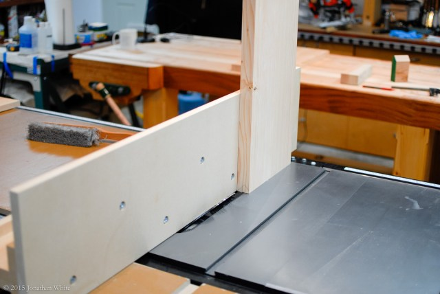 A tall fence mounted on the table saw.