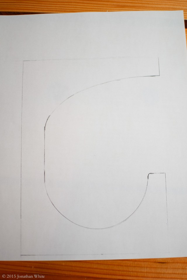 Using a cut-off piece of PVC pipe as guide, I drew this design for the bracket.