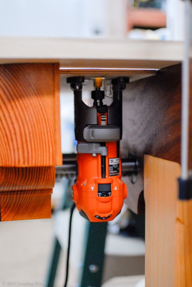 I screwed my trim router to a piece of plywood and made a makeshift router table.