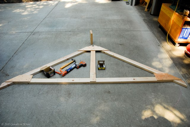 The plywood plates were glued, screwed, and nailed to the truss members.