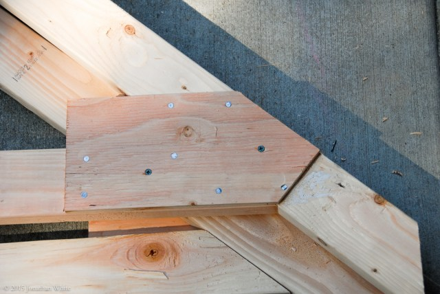 I realized after the fact, that the plywood plates would get in the way of the blocking when the trusses are installed. I trimmed them back with a sash saw.