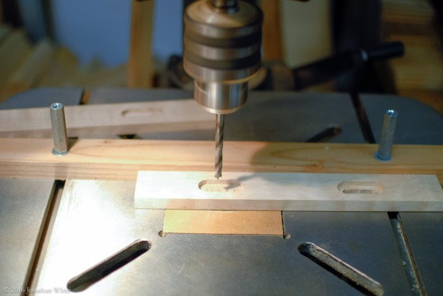 With the fence set in the same position, I drilled a series of through holes with a ¼-inch bit to create the slot.