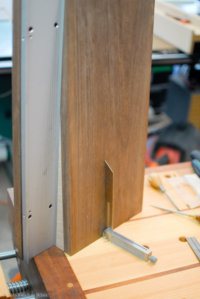 I stood the shooting board up on the bench and set a sliding bevel to the match the angle.