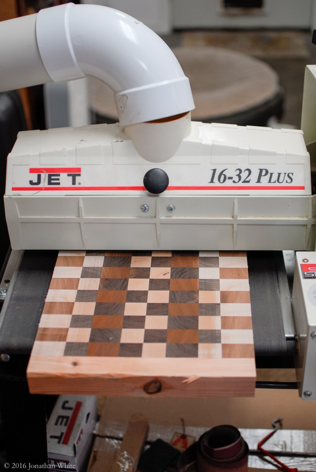 After the planer, I fed the boards through the drum sander.