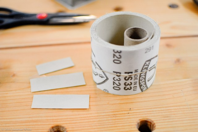 I cut some strips of self-adhesive sandpaper.