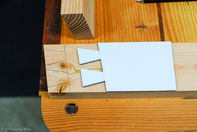 I used some cardboard to design a template for the dovetails.