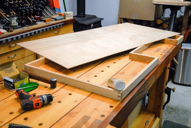 I cut an appropriately sized piece of ¼-inch ply for the bottom of the drawer. This was glued and nailed in place.
