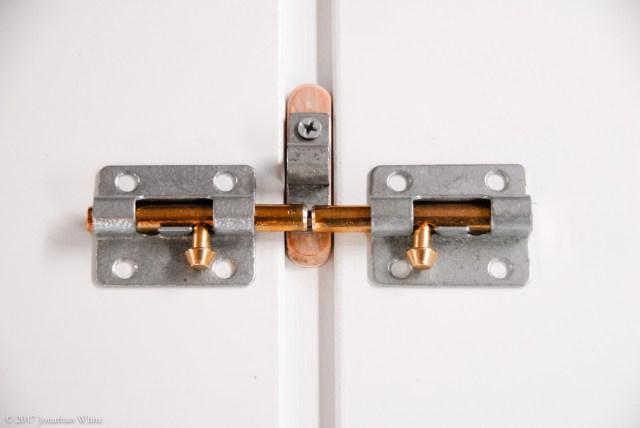 Installing some door latches.