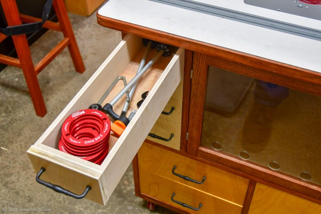 The top left drawer is handy for storage of needed accessories.