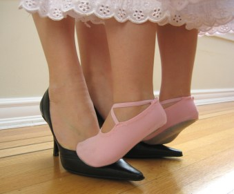 """For the song """"Dancing Feet"""" I love this cute image of the little girl on her mum's shoes"""