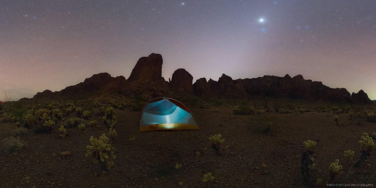 Zodiacal light glows in the night sky.
