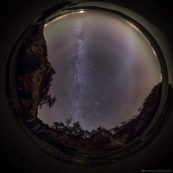 Zodiacal light, airglow, and the Milky Way shine in the night sky in this upward-facing view taken at the Oregon coast.