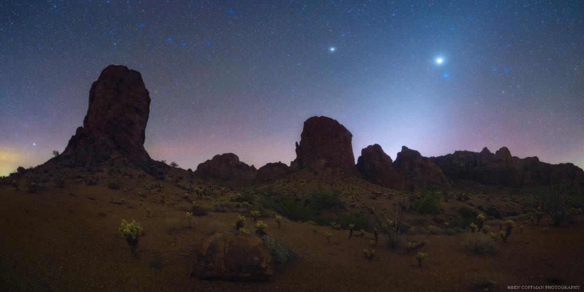 The planet Jupiter hangs over the jagged peaks of Arizona's Kofa Mountains.