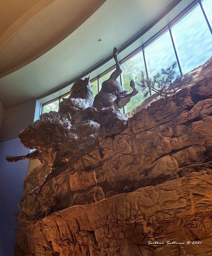 Bison jump sculpture in Cody