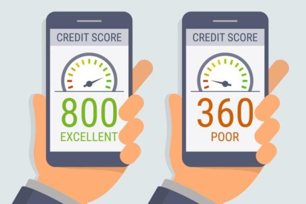 hands holding smartphones with credit score app