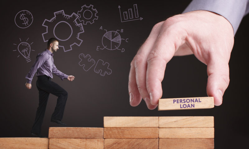 young businessman shows the word personal loan