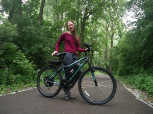 Natalia standing on a bike path with her newly built ebike