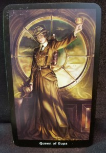 Woman in Steampunk dress holding chalices in both hands
