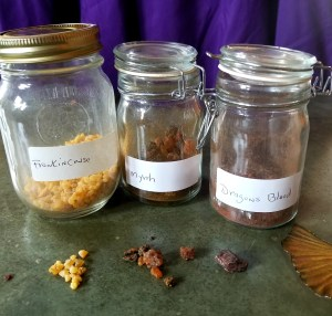 Three jar of resins that can be used in incense - frankincense, myrrh and Dragon's Blood