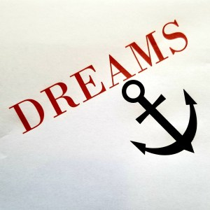 The word dreams being weighed down by an anchor