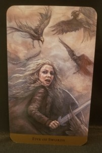 Five of Swords - a battle ready woman surrounded by ravens