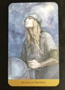 Seven of Swords - A man dressed in chain maile looking up to the stars