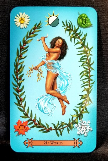 The World - Tarot Card:  A beautiful woman draped in waves